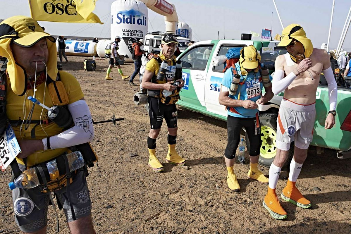 Competitors get ready before the 31st edition of the Marathon des Sables, on April 10, 2016.