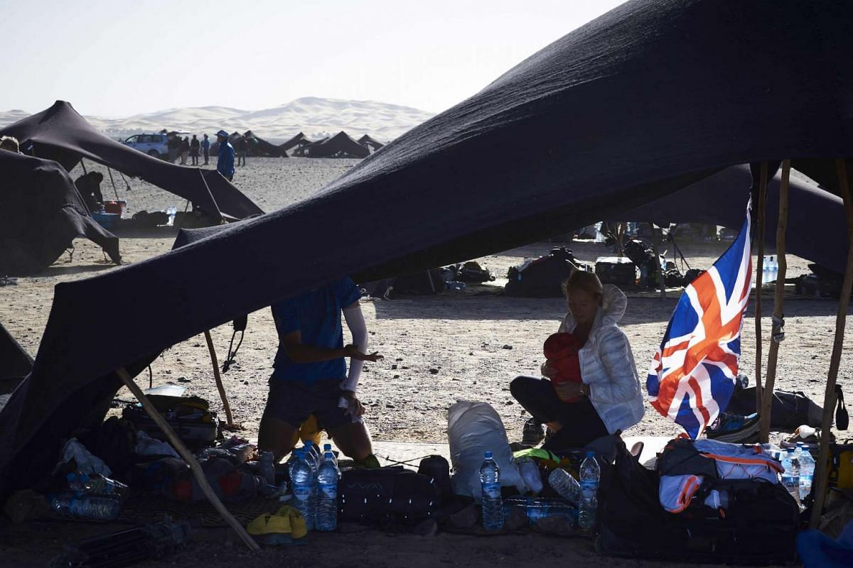 Competitors sit inside their tent on the eve of the 31st edition of the Marathon des Sables, on April 9, 2016.