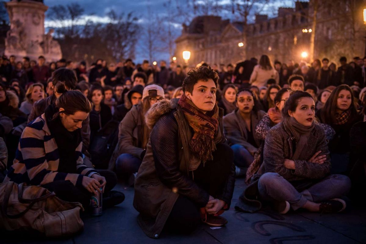 Participants of the social media-born movement dubbed 'La Nuit Debout' ('The Night awake' or 'The night standing up') take part in a general assembly sit-in on Place de la Republique, to protest against the labor law reform bill in Paris, France, Apr