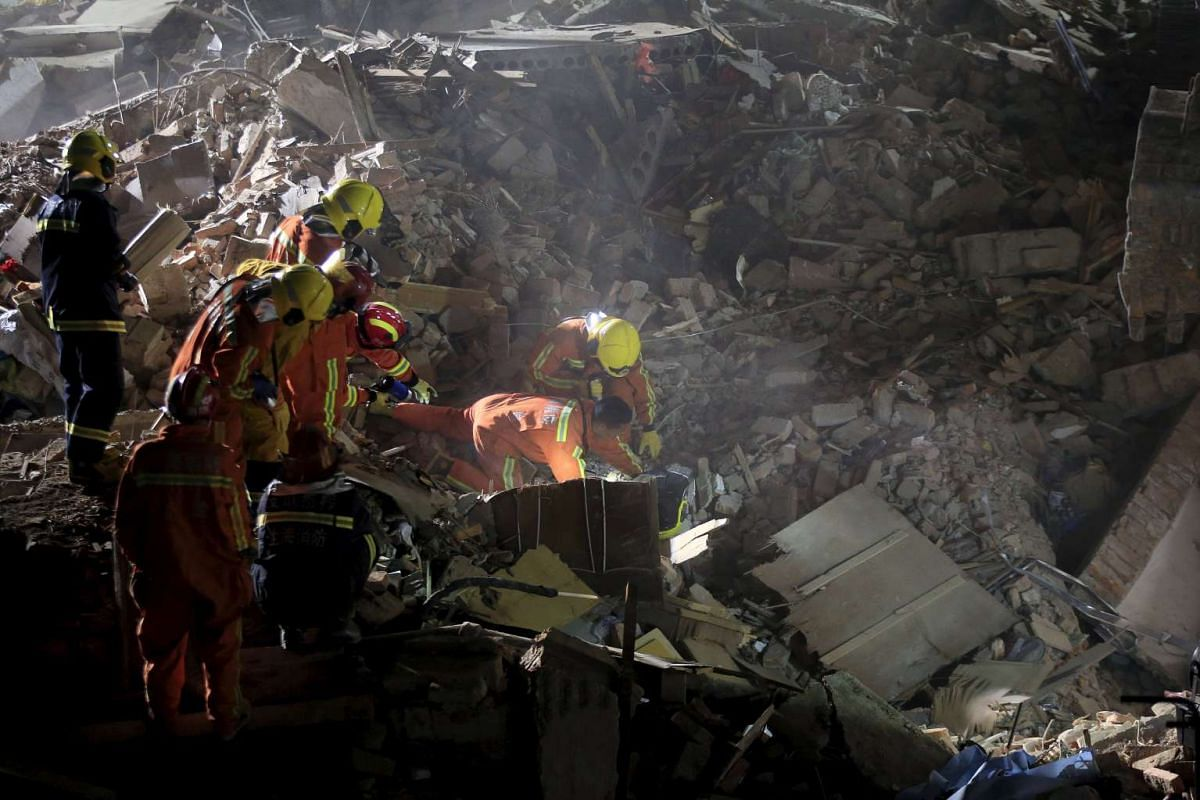 Rescue workers search at the site after a three-storey residential building collapsed in Shanghai, China, April 11, 2016. PHOTO: REUTERS