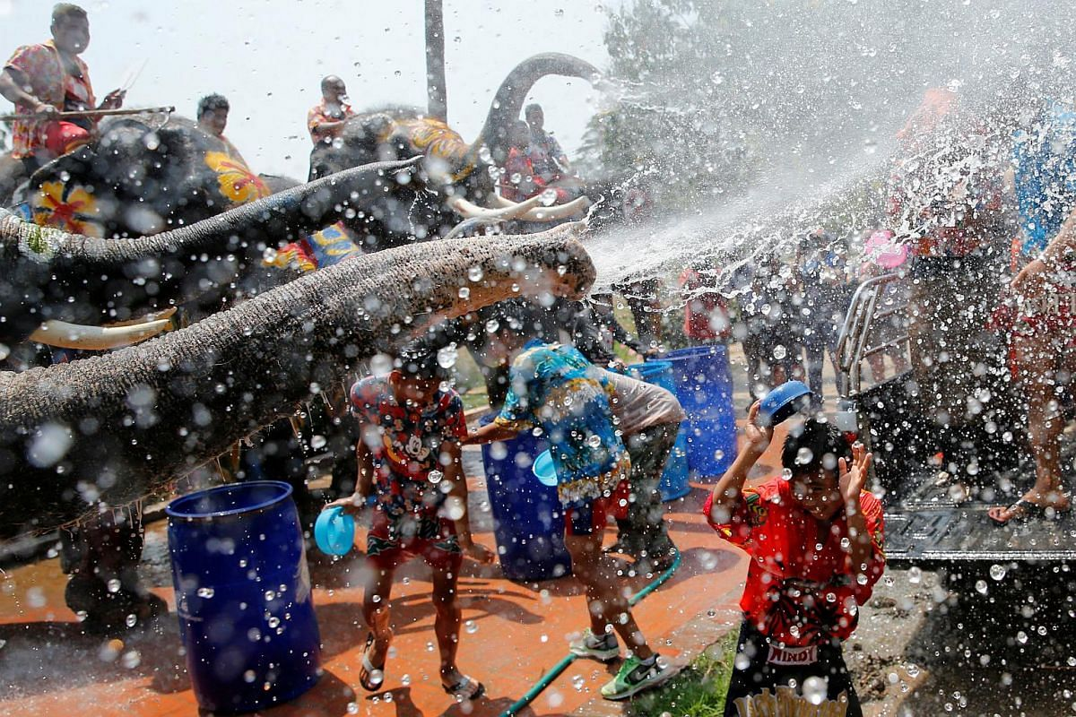 Elephants spraying children with water in Thailand's Ayutthaya province on April 11.