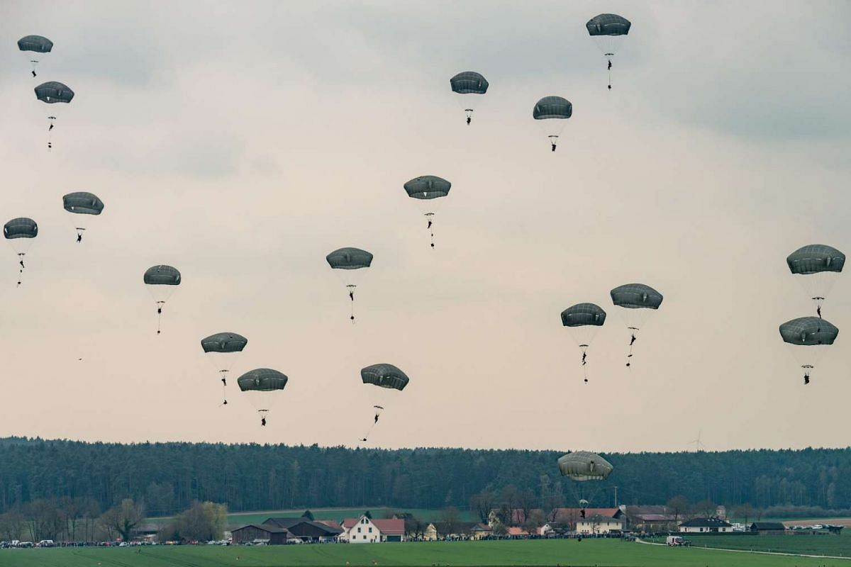 Parachutists jump from an airplane near Burgenlengenfeld, Germany, on April 12, 2016. The airborne manoeuvre is part of the Saber Junction 16 drill. PHOTO: EPA