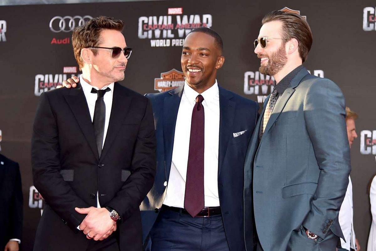 (From left) Actors Robert Downey Jr, Anthony Mackie and Chris Evans attend the premiere of Marvel's Captain America: Civil War at Dolby Theatre on April 12, 2016 in Los Angeles, California.