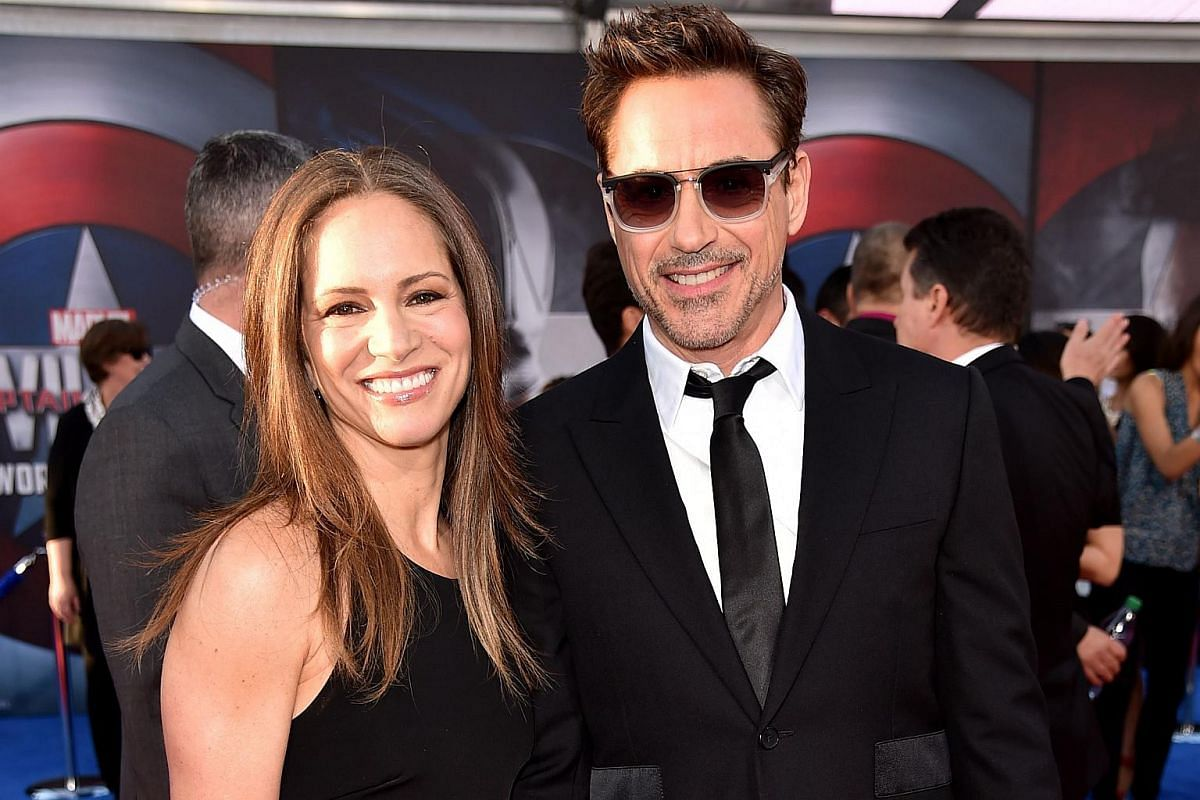 Producer Susan Downey (left) and actor Robert Downey Jr attend the premiere of Marvel's Captain America: Civil War at Dolby Theatre on April 12, 2016.
