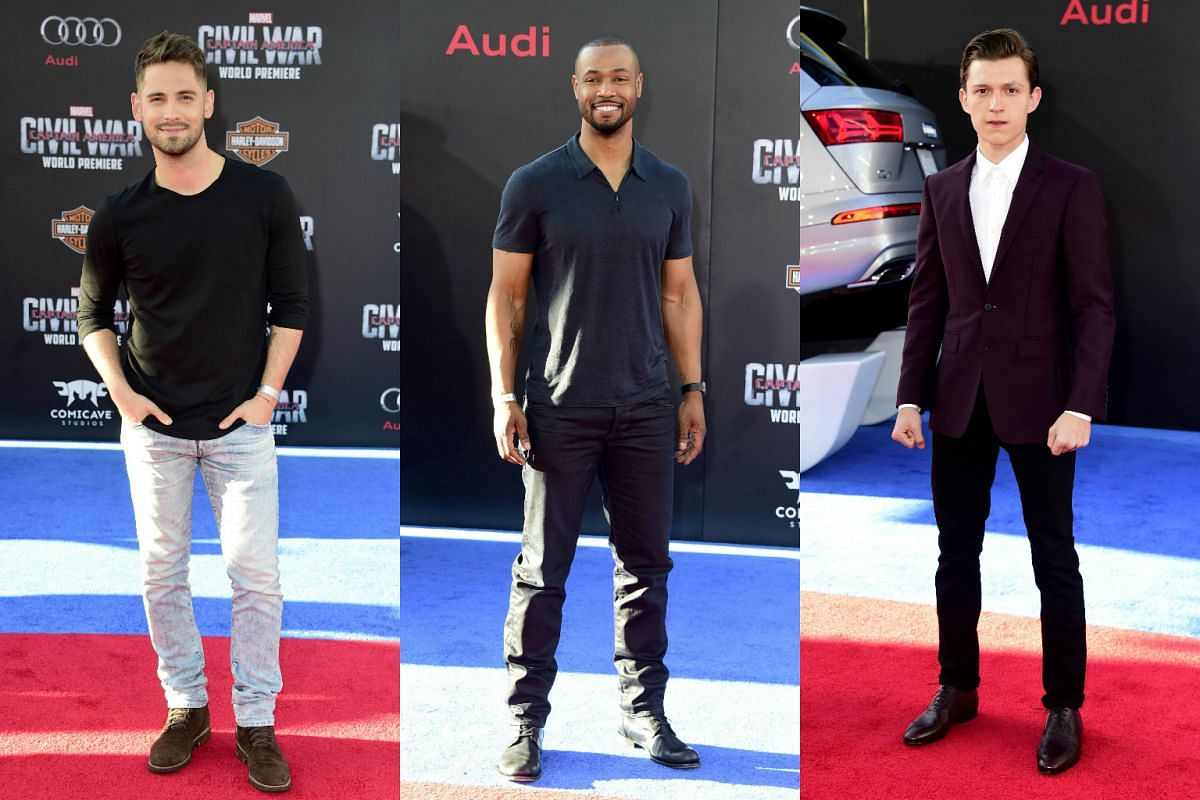 (From left) Actors Jean-Luc Bilodeau, Isaiah Mustafa and Nathan Fillion attends the premiere of Marvel's Captain America: Civil War at Dolby Theatre on April 12, 2016.