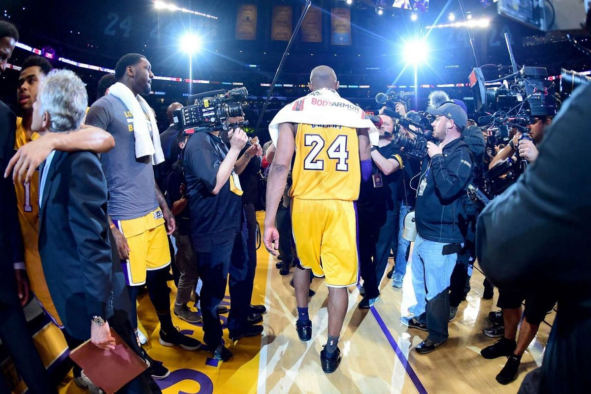 Kobe Bryant #24 of the Los Angeles Lakers walks towards the tunnel after scoring 60 points against the Utah Jazz at Staples Center, thus ending his stellar 20-year NBA career, on April 13, 2016 in Los Angeles, California. PHOTO: GETTY IMAGES/AFP