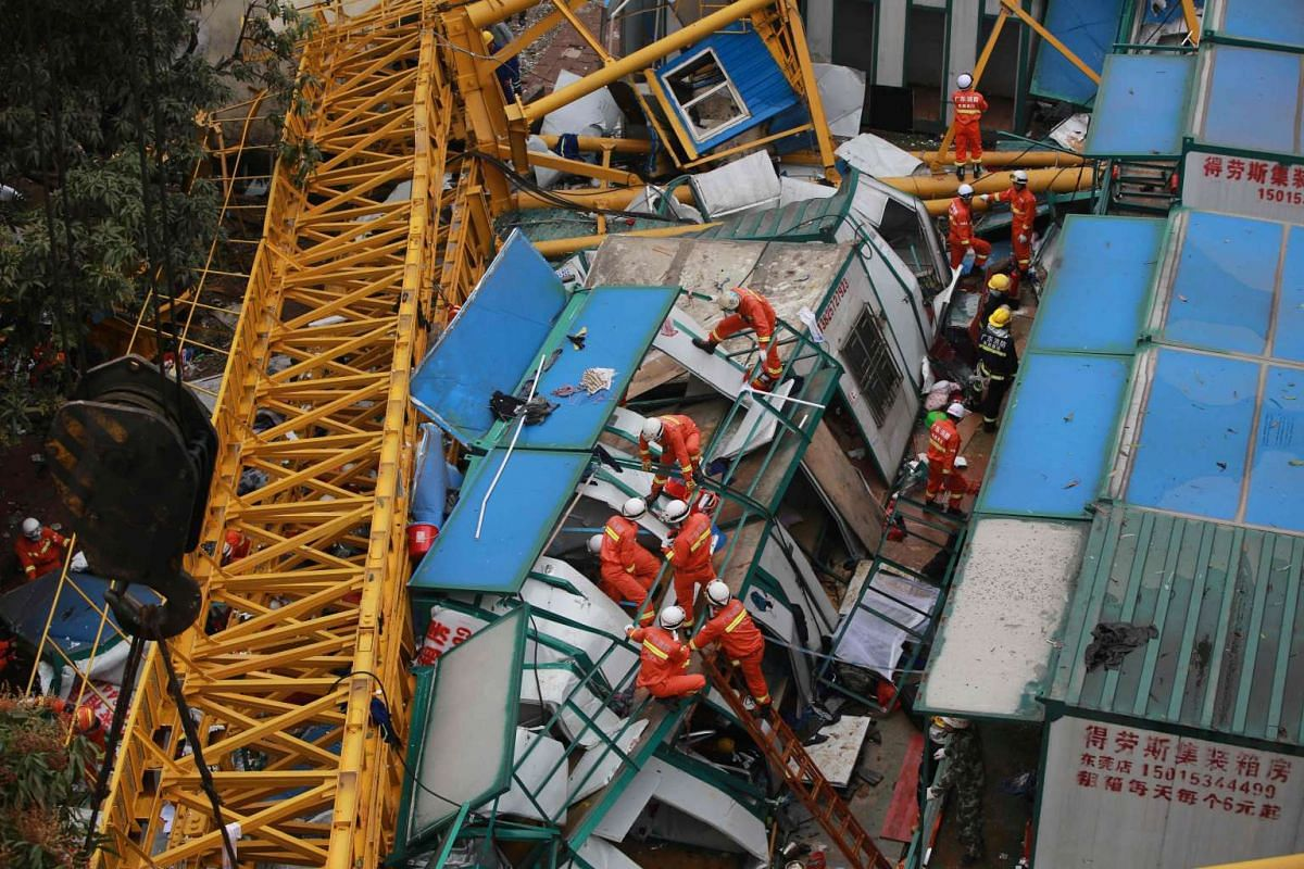 Rescuers work at the accident site of a collapsed temporary structure after it was hit by a crane in a construction site in Mayong Township of Dongguan City, south China's Guangdong Province on April 13, 2016. PHOTO: AFP