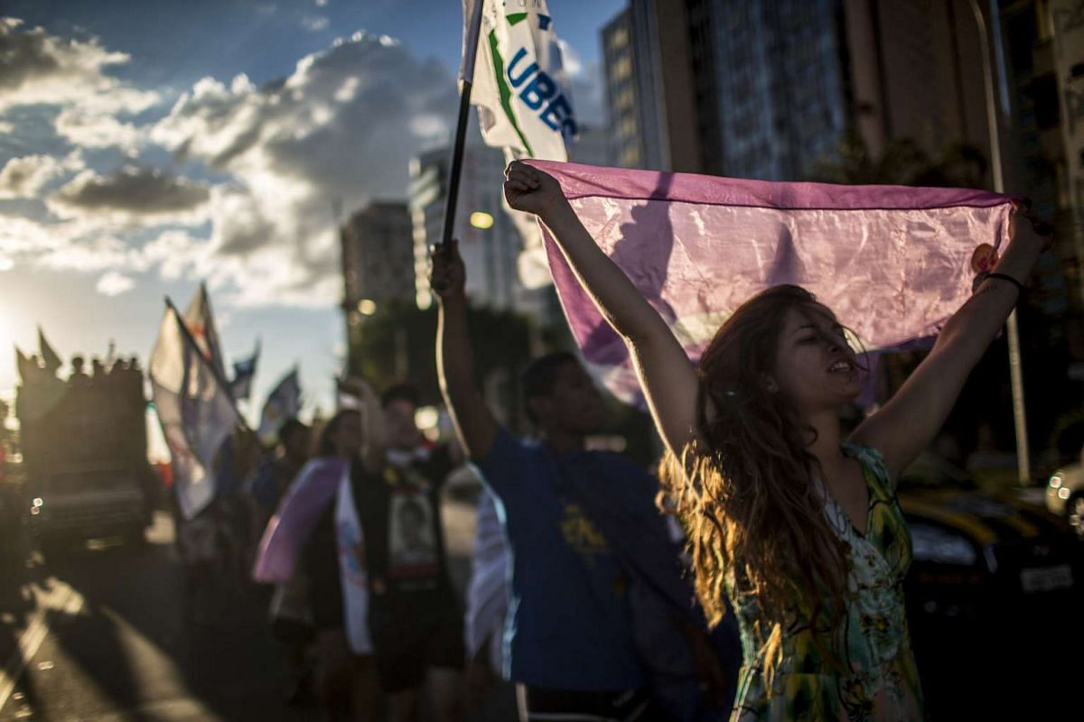 Demonstrators from the Landless Workers Movement, Movimento dos Trabalhadores Rurais Sem Terra (MST), chant in support of Dilma Rousseff, Brazil's President, not pictured, and the ruling Workers Party (PT), outside the Congress in Brasilia, Brazil, o