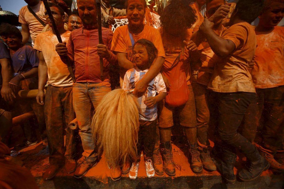 "Devotees celebrate the ""Sindoor Jatra"" vermilion powder festival at Thimi, in Bhaktapur, Nepal, on April 14, 2016."