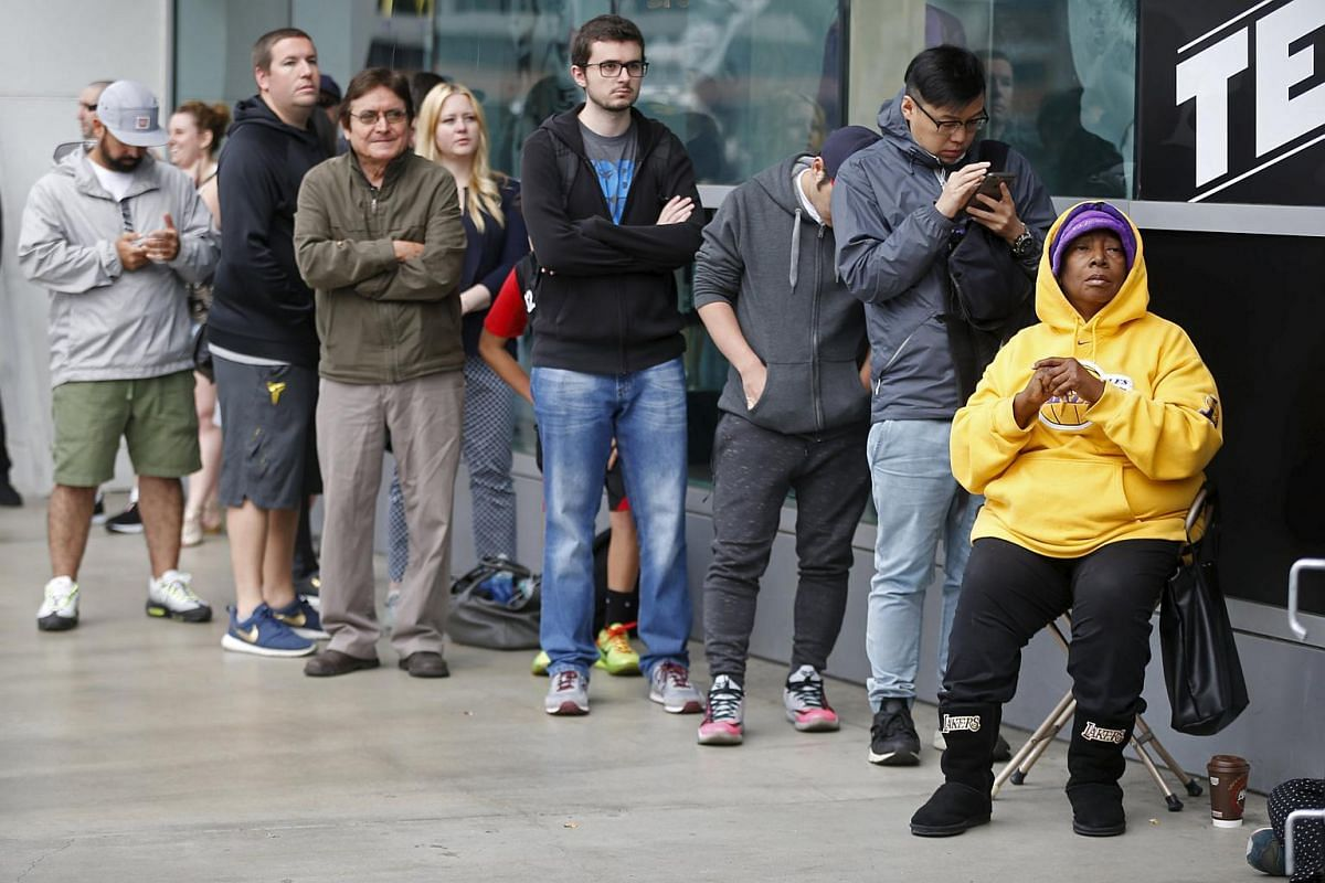People wait in line to buy Kobe Bryant souvenirs outside Staples Center on the last day of Kobe's 20-year career with the team, on April 13, 2016.