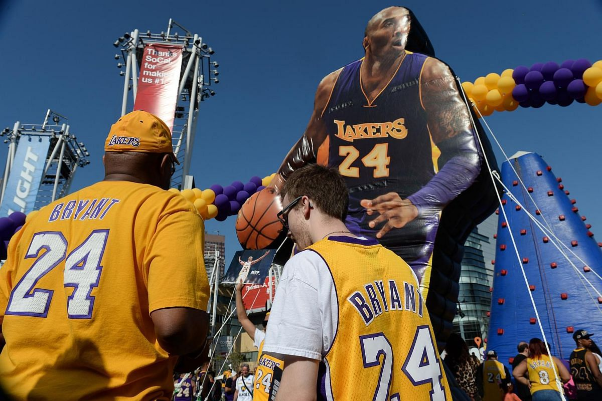 Kobe Bryant fans look at an interactive area in front of Staples Center before the start of the Los Angeles Lakers game.