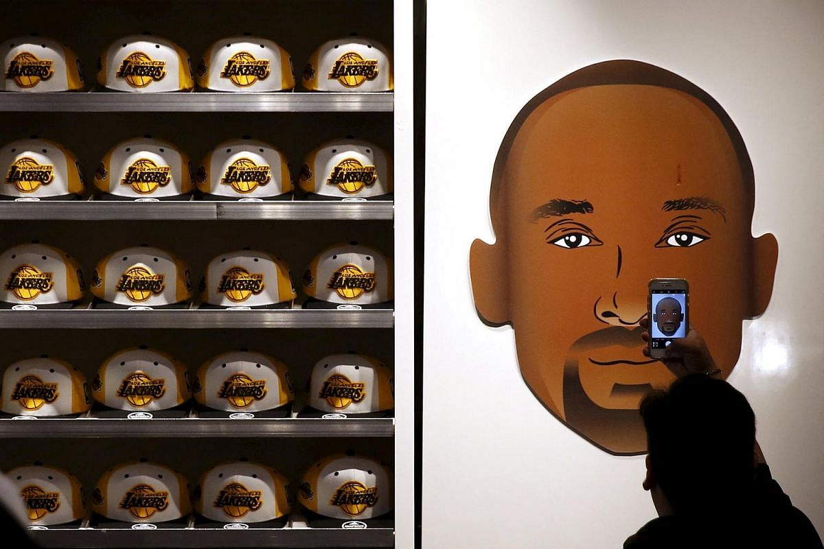 Souvenir baseball caps of Kobe Bryant in the Lakers store at Staples Center on April 13, 2016.