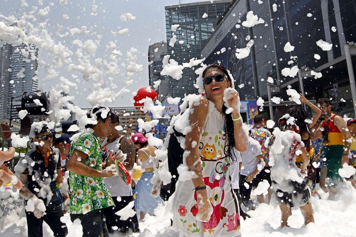 Foreign and Thai revelers dances amid foams during a foam party as part of the annual Songkran celebration, the Thai traditional New Year also known as the water festival in Bangkok, Thailand, April 14, 2016. PHOTO: EPA