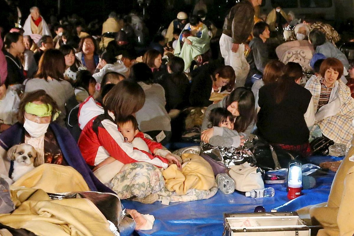 Evacuees gather in front of the town office building after an earthquake in Mashiki town, Kumamoto, Japan, on April 15, 2016.