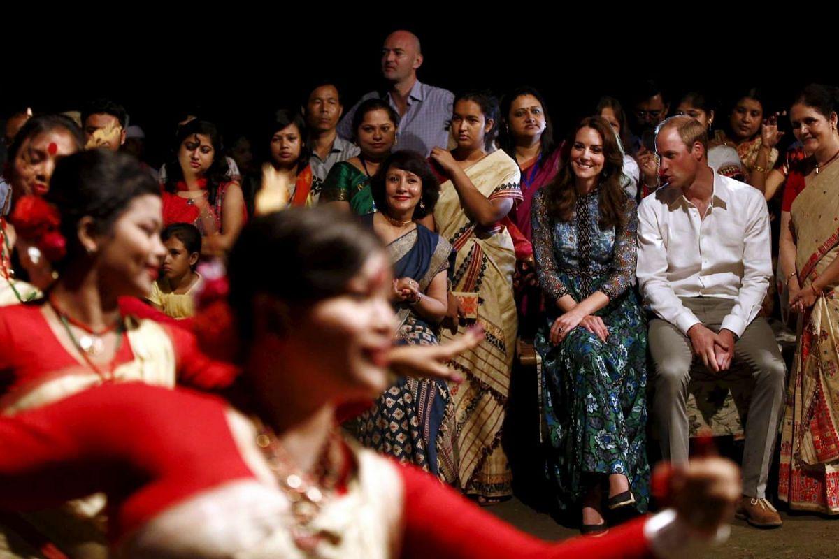 The Duke and Duchess of Cambridge watch dancers perform Bihu dance, in Assam, India, on April 12, 2016.