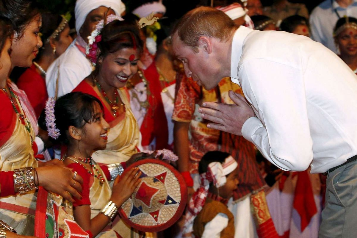Prince William greets a Bihu dancer after their performance at a tourist lodge in Kaziranga in the north-eastern state of Assam, India, on April 12, 2016.