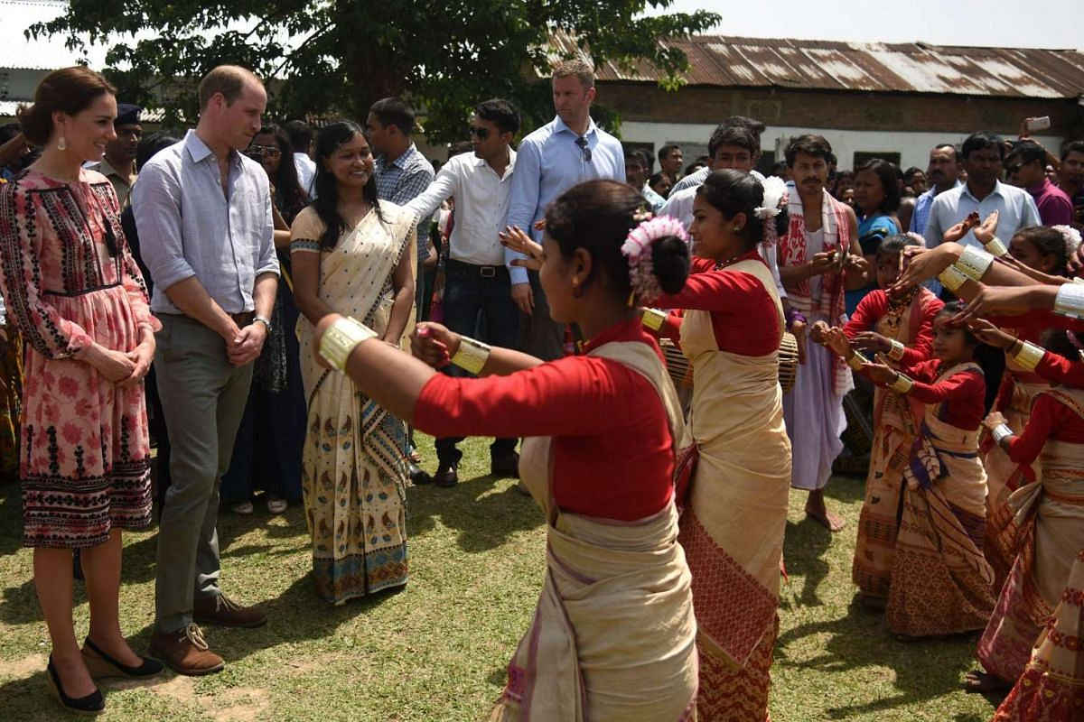 William and Kate watch a traditional dance in Panbari village in Kaziranga, India, on April 13, 2016.