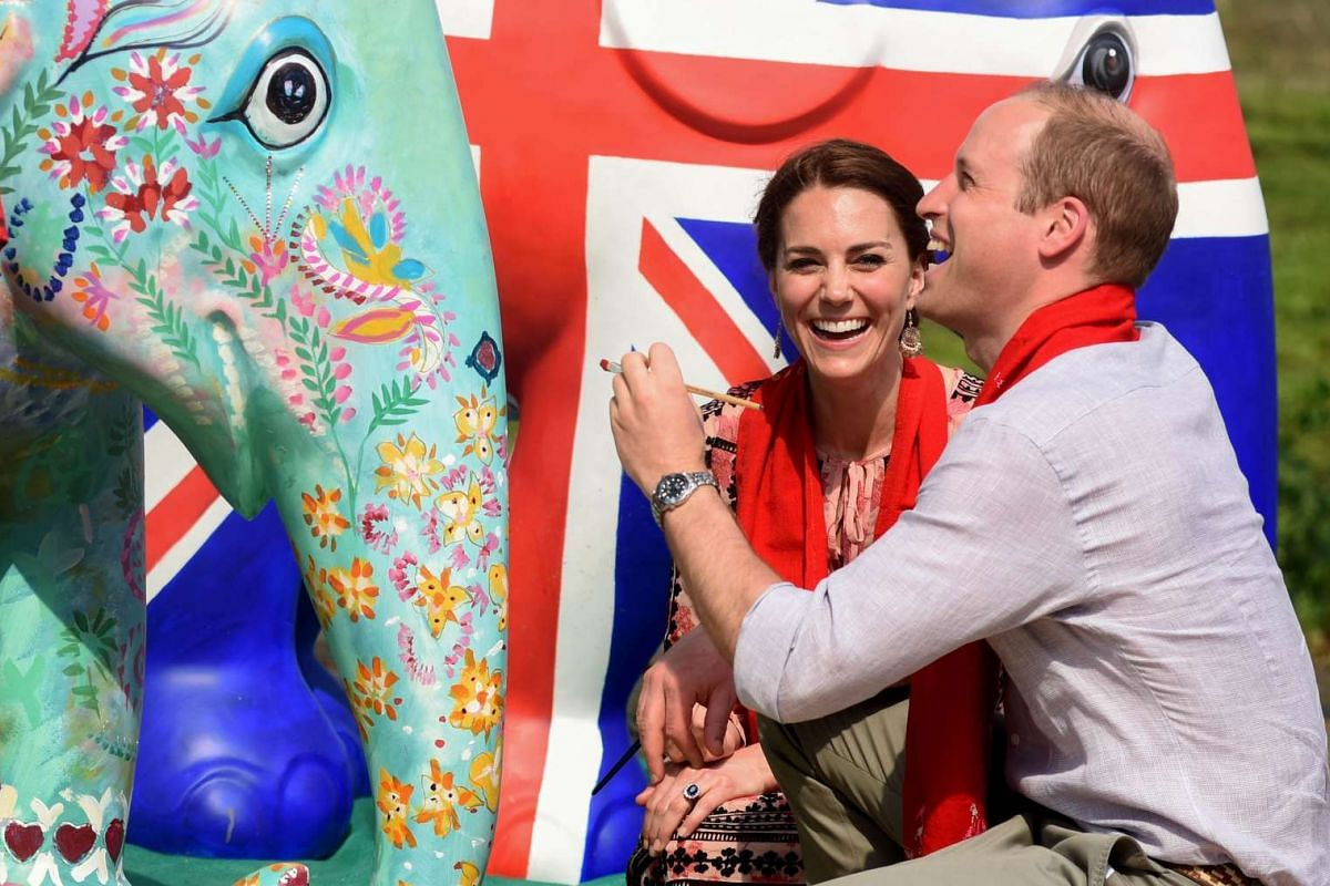 The Duke and Duchess of Cambridge paint an elephant statue at Kaziranga Discovery Park in Panbari village, India, on April 13, 2016.