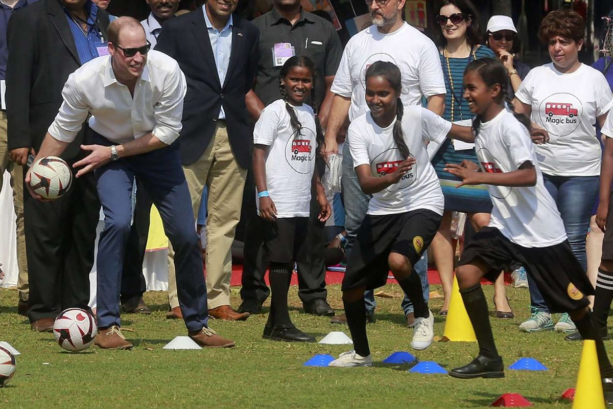 Prince William plays with Indian children who are beneficiaries of NGOs at the Oval Maidan in Mumbai, on April 10, 2016.