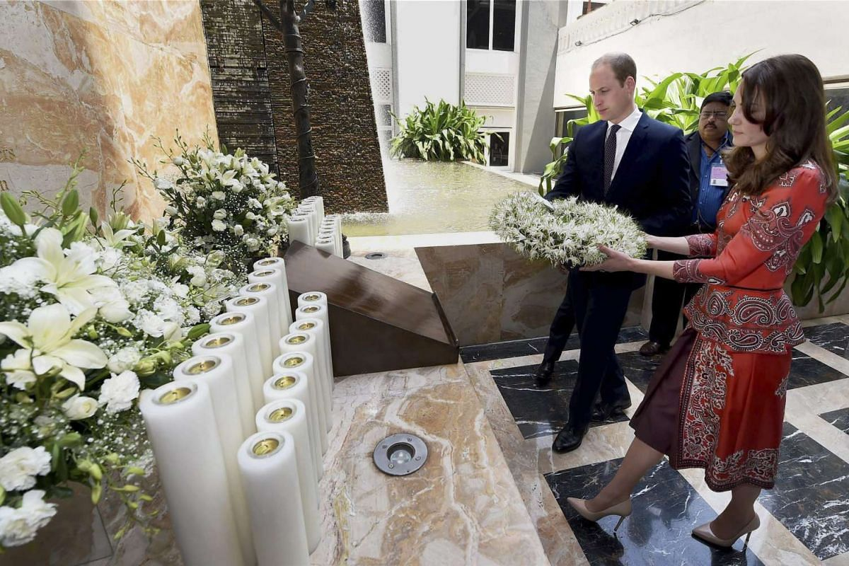 Prince William with his wife Catherine attend a wreath-laying ceremony on the martyrs memorial at the Taj Mahal Palace Hotel in Mumbai, India, on April 10, 2016.