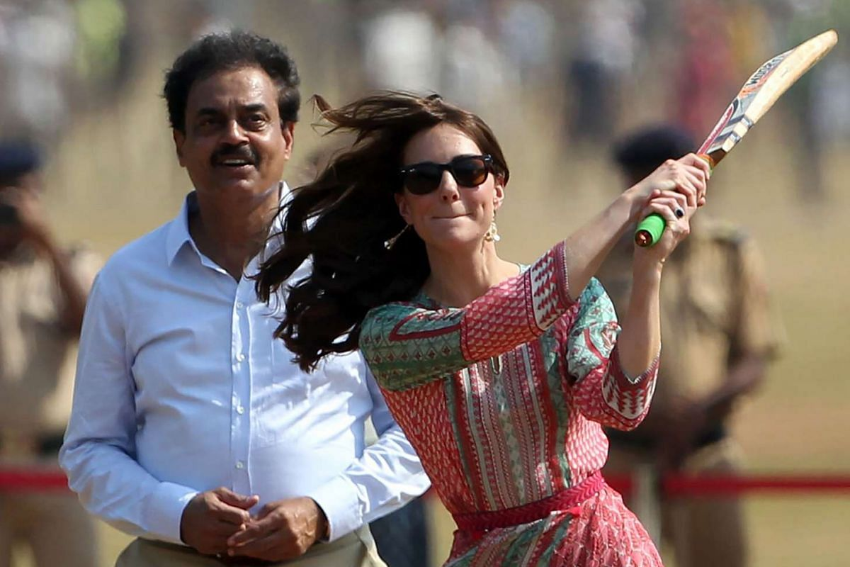 Former Indian cricketer Dilip Vengsarkar looks on as the Duke and Duchess of Cambridge play a game of cricket with Indian children, on April 10, 2016.