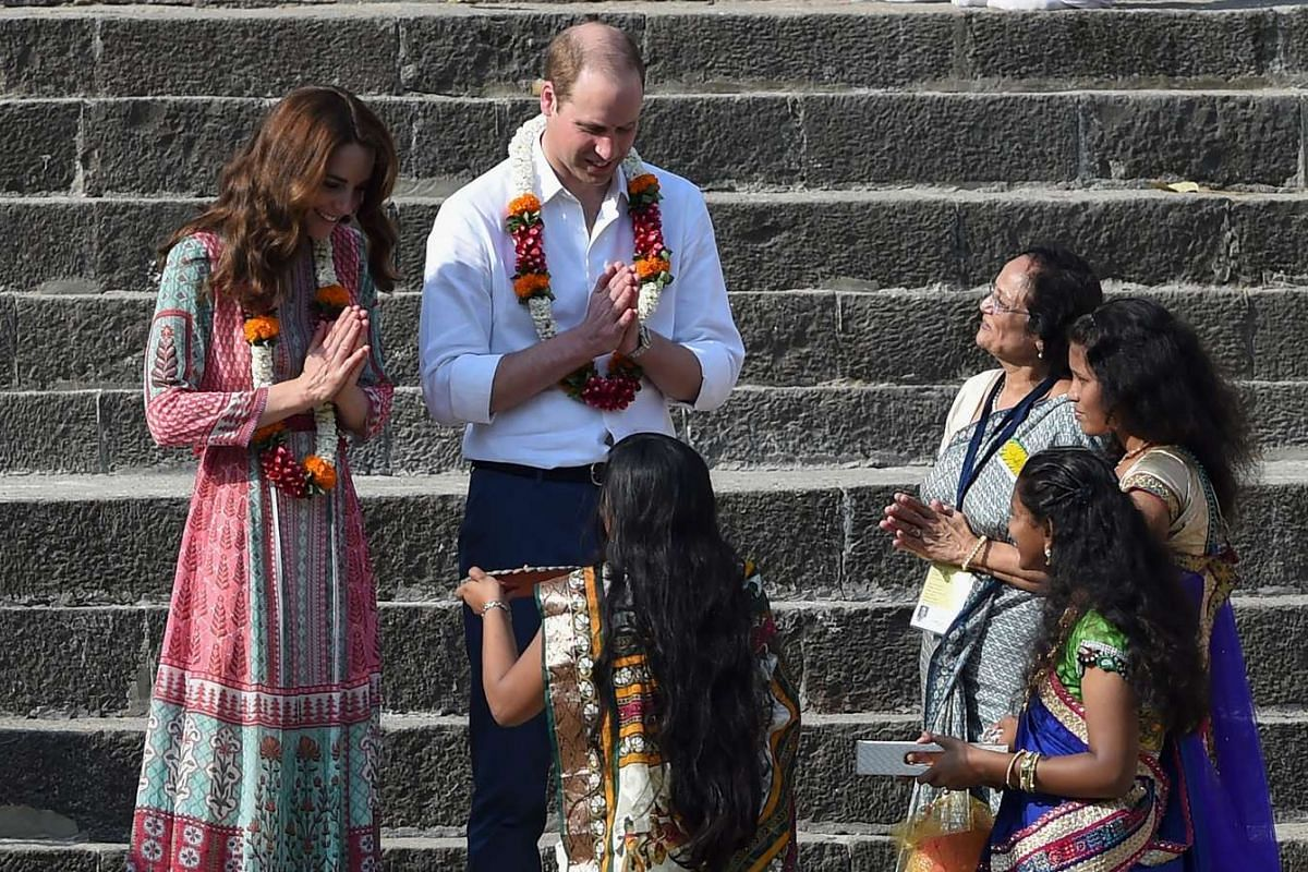 William and Kate receive a traditional welcome as they visit the historic Banganga water tank in Mumbai, on April 10, 2016.