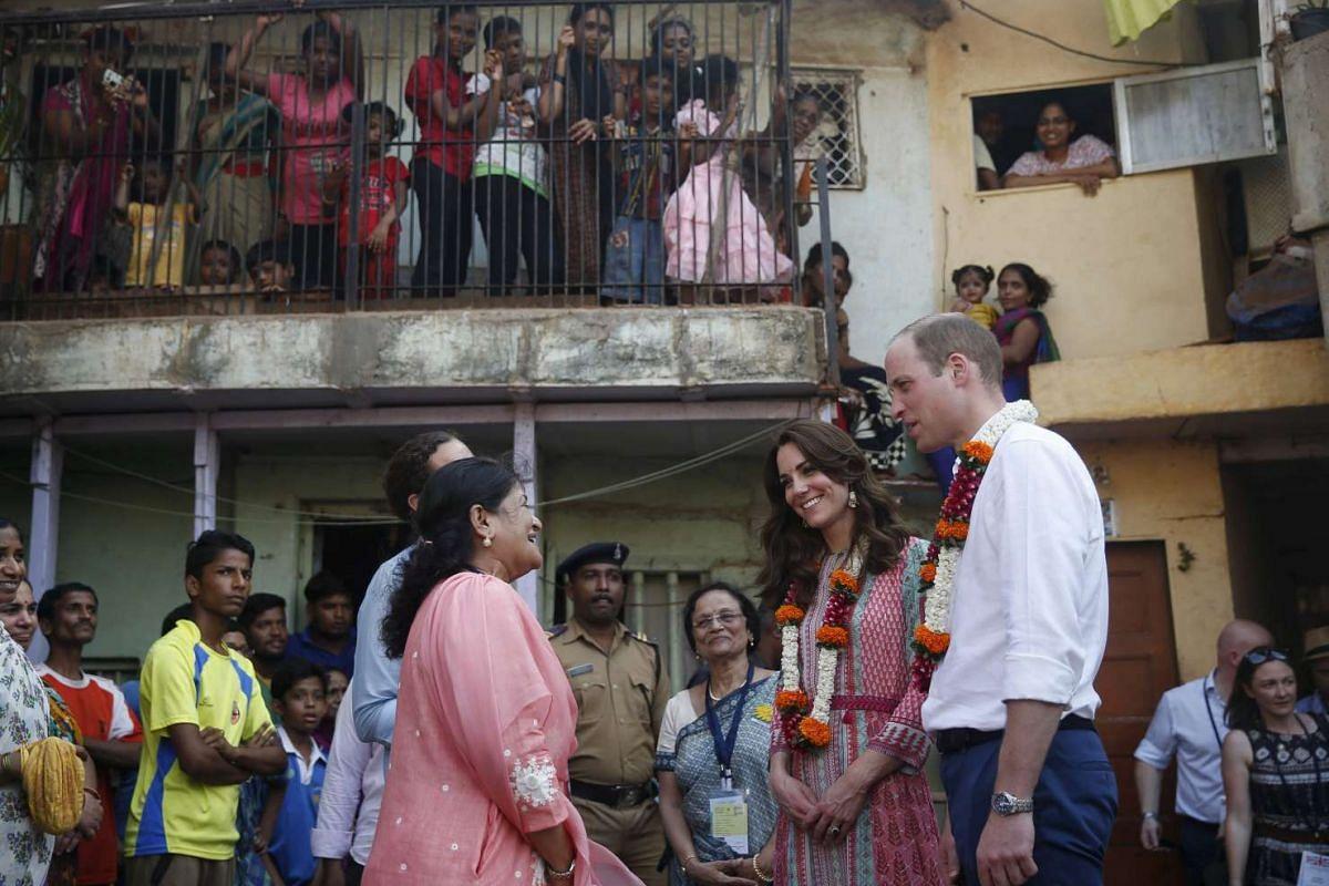 WIlliam and Kate visit a slum in Mumbai, India, on April 10, 2016.