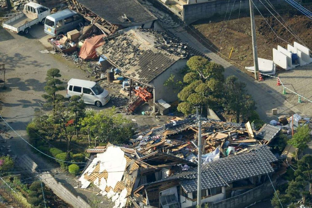 Collapsed houses caused by an earthquake are seen in Mashiki town, Kumamoto, Japan, on April 15, 2016.
