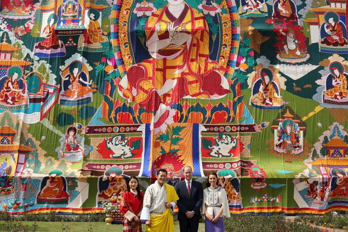 Bhutan's Queen Jetsun Pema and King Jigme Khesar Namgyel Wangchuck pose with Britain's Prince William and his wife Catherine at the Tashichho Dzong in Thimphu, Bhutan, on April 14, 2016.