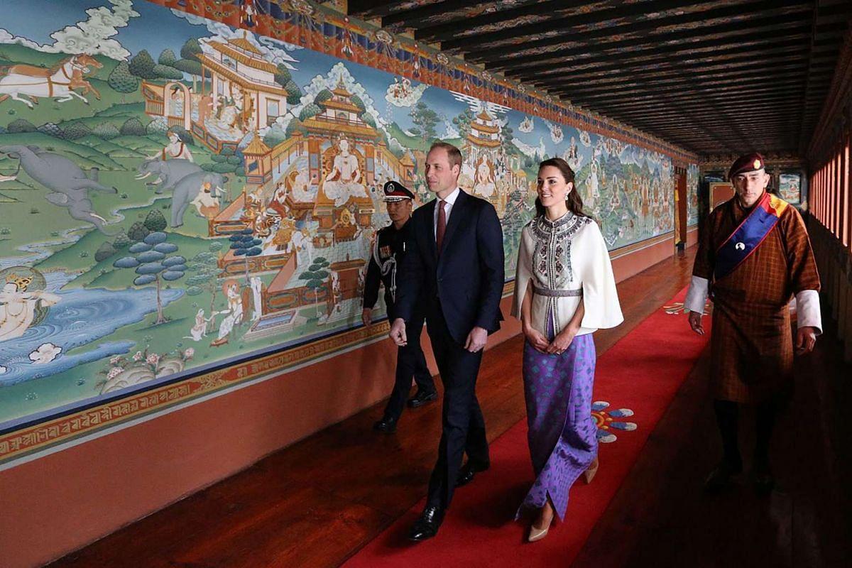 Britain's Duke of Cambridge Prince William and his wife Catherine, Duchess of Cambridge, walk through Lingkana Palace, on April 14, 2016.