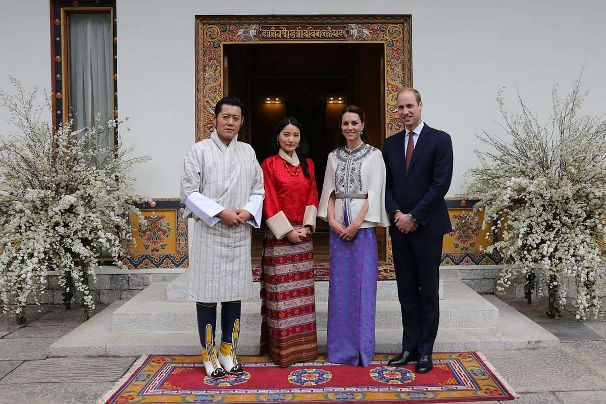 Bhutan's King Jigme Khesar Namgyel Wangchuck and Queen Jetsun Pema pose with Britain's Prince William and his wife Catherine at the Tashichho Dzong in Thimphu, Bhutan, on April 14, 2016.