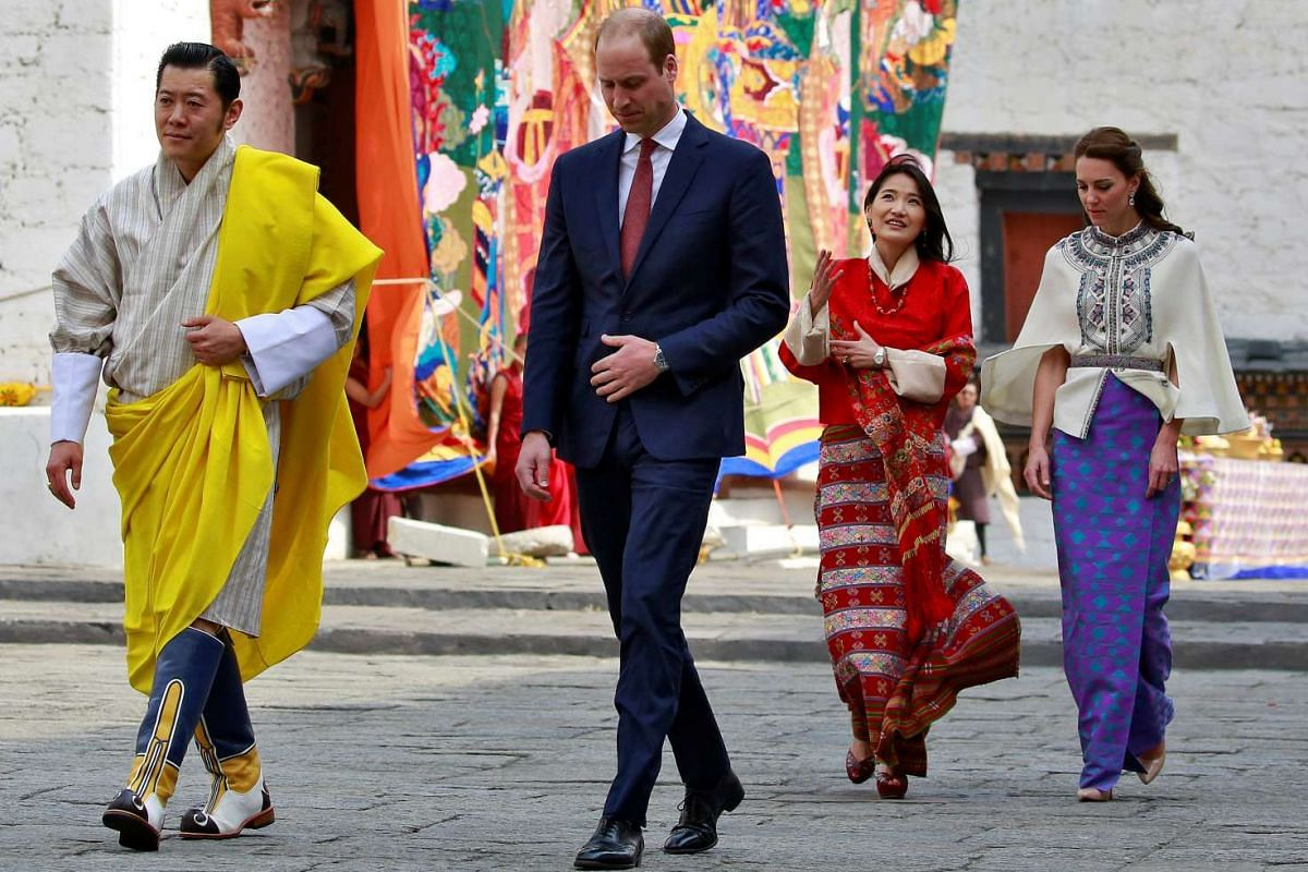 Britain's Duke and Duchess of Cambridge are shown around the Tashichho Dzong temple by King Jigme Khesar Namgyel Wangchuck and his wife Jetsun Pema in Thimphu, on April 14, 2016.
