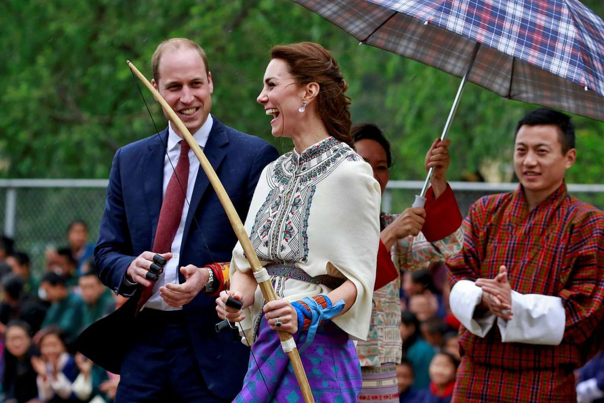 Britain's Catherine, Duchess of Cambridge, reacts after shooting an arrow at Changlimithang Archery Ground, on April 14, 2016.