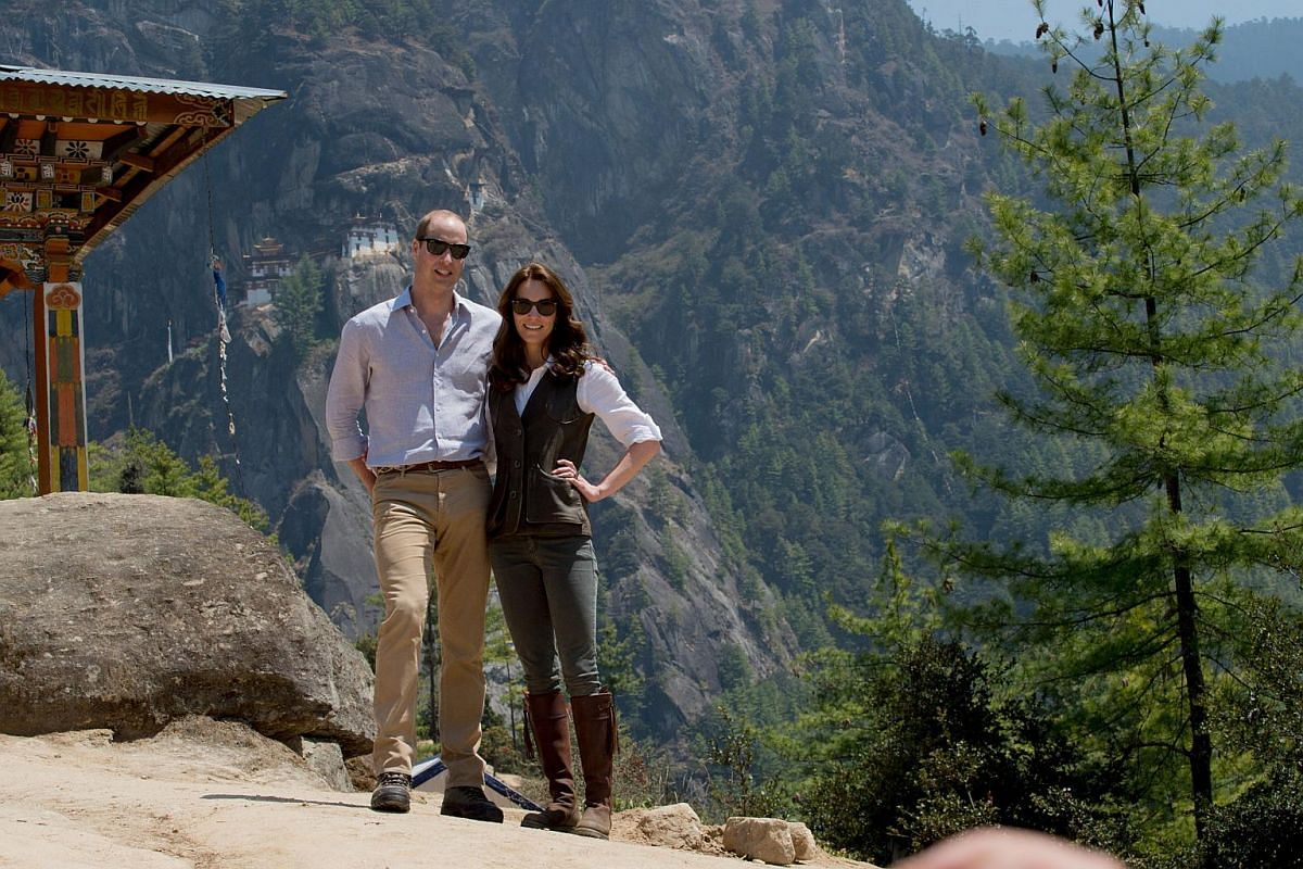 Britain's Prince William (left), Duke of Cambridge, and Catherine, Duchess of Cambridge, halfway up the trail leading to a Buddhist monastery, Tiger's Nest, on their visit to Bhutan, on April 15, 2016.