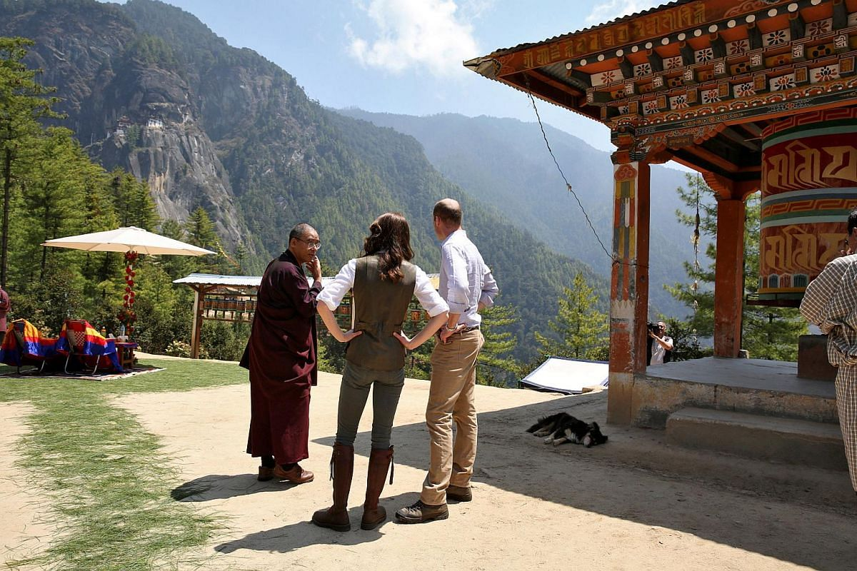 William and Kate listen to Khenpo Phuntsok Tashi, Director of Bhutan's National Museum, at the Paro Taktsang Monastery, Bhutan, on April 15, 2016.