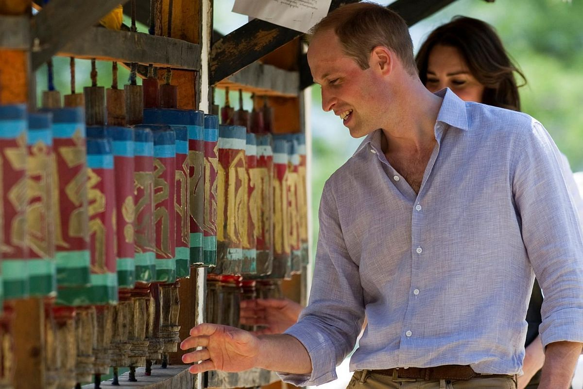 William and Kate spin prayer wheels at the Paro Taktsang Monastery, Bhutan, on April 15, 2016.