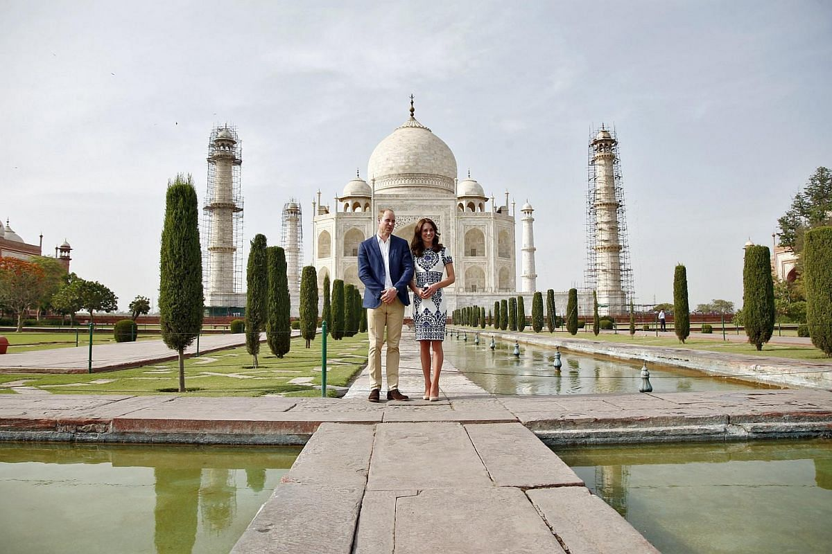 Britain's Prince William and his wife Catherine, the Duchess of Cambridge, pose in front of the Taj Mahal in Agra, India, on April 16, 2016.