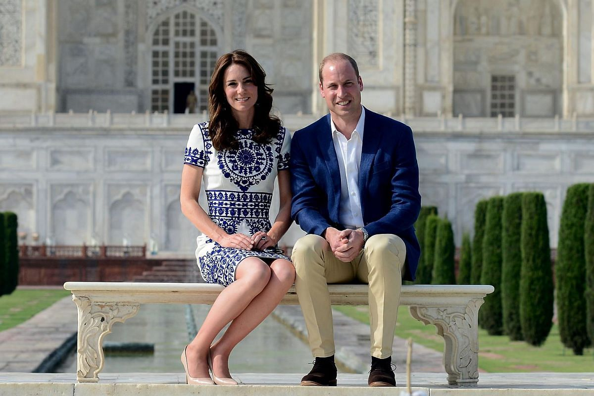 William and Kate pose during their visit to the Taj Mahal in Agra, on April 16, 2016.