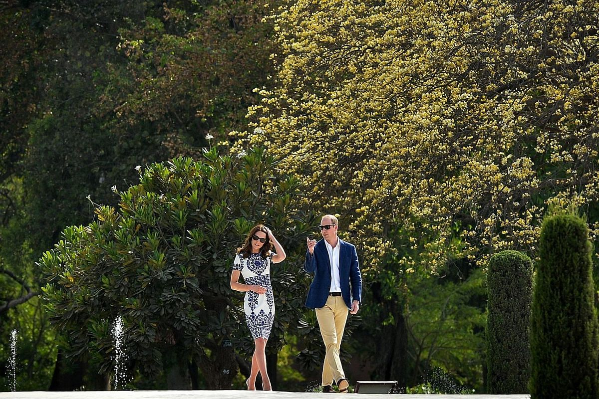 William and Kate walk through the grounds of the Taj Mahal in Agra, on April 16, 2016.
