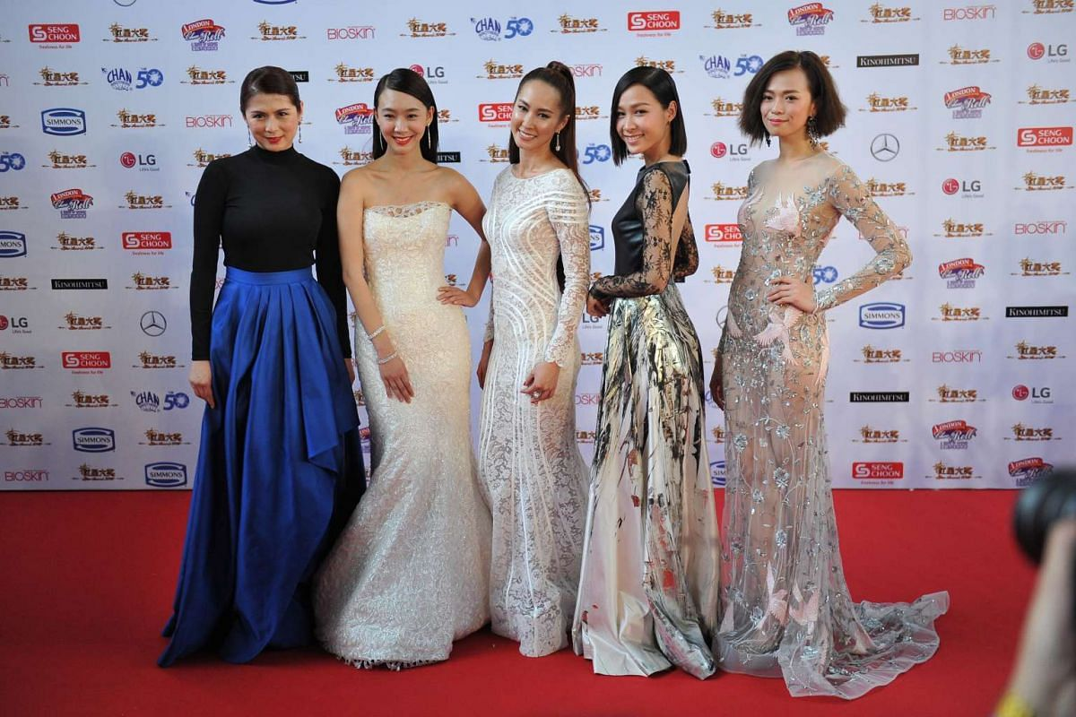 (From left) Pan Lingling, Julie Tan, Paige Chua, Ya Hui and Felicia Chin pose for the media on the red carpet of the Star Awards 2016.