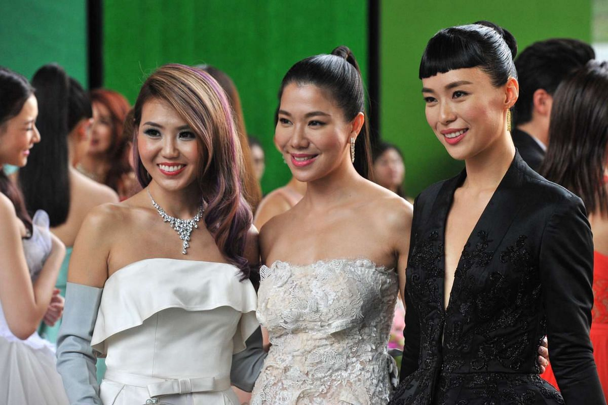 (From left) Tay Kewei, Belinda Lee and Rebecca Lim pose for the media on the red carpet of the Star Awards 2016.