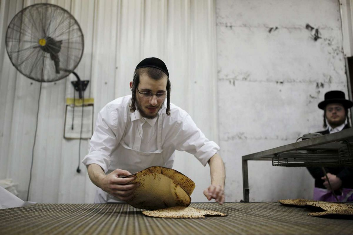 An ultra-Orthodox Jewish picks fresh matza during the Jewish holiday of Passover in Ashdod, on April 17, 2016.