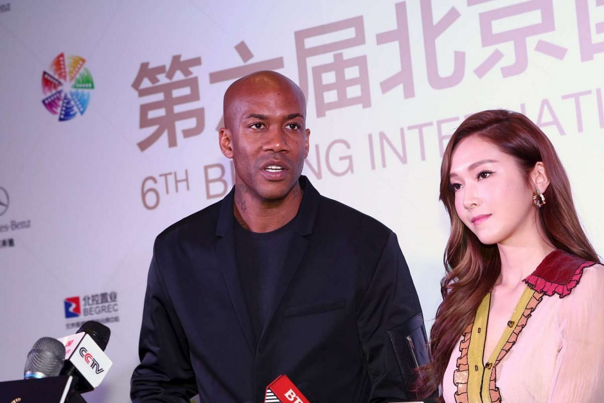 Singer Jessica Jung and former NBA player Stephon Marbury arrive at the Beijing International Film Festival, in Beijing, on April 16, 2016.