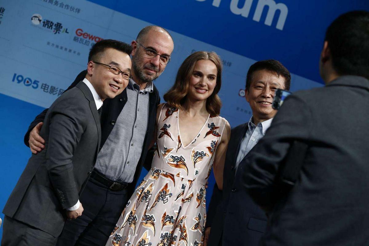 From left: Hong Kong animator Raman Hui, Italian filmmaker Giuseppe Tornatore, US actress Natalie Portman and Chinese panel moderator Huang Jianxin pose for a photograph.