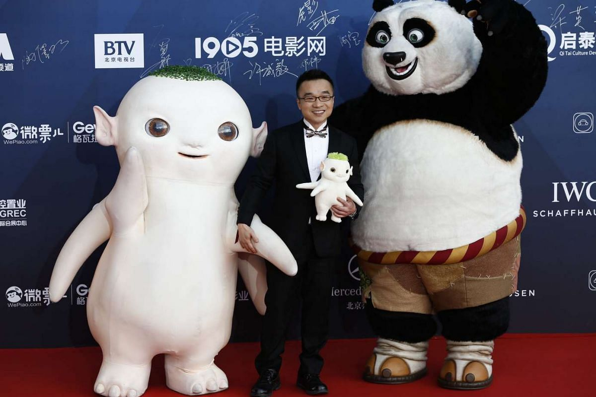 Hong Kong actor and animator Raman Hui (centre) and characters from Monster Hunt and Kung Fu Panda arrive for the opening ceremony.