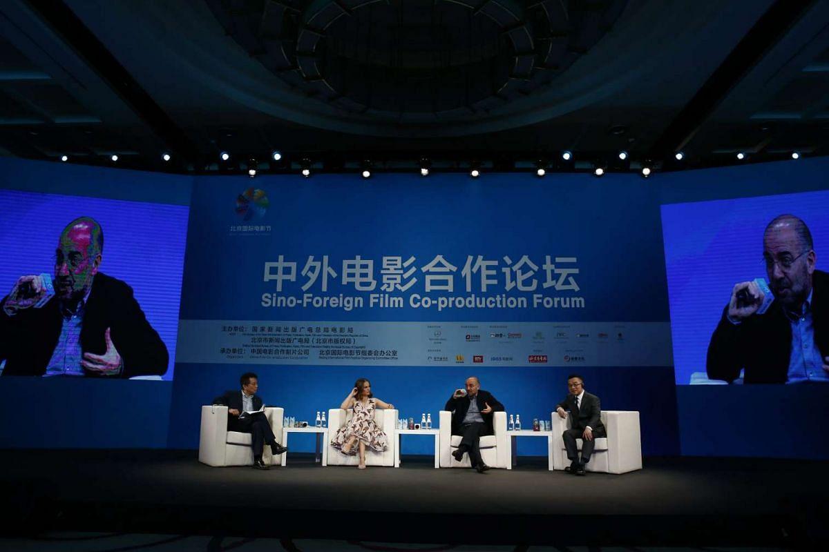 From left: Chinese moderator Huang Jianxin, US actress Natalie Portman, Italian filmmaker Giuseppe Tornatore and Hong Kong animator Raman Hui at the panel discussion.