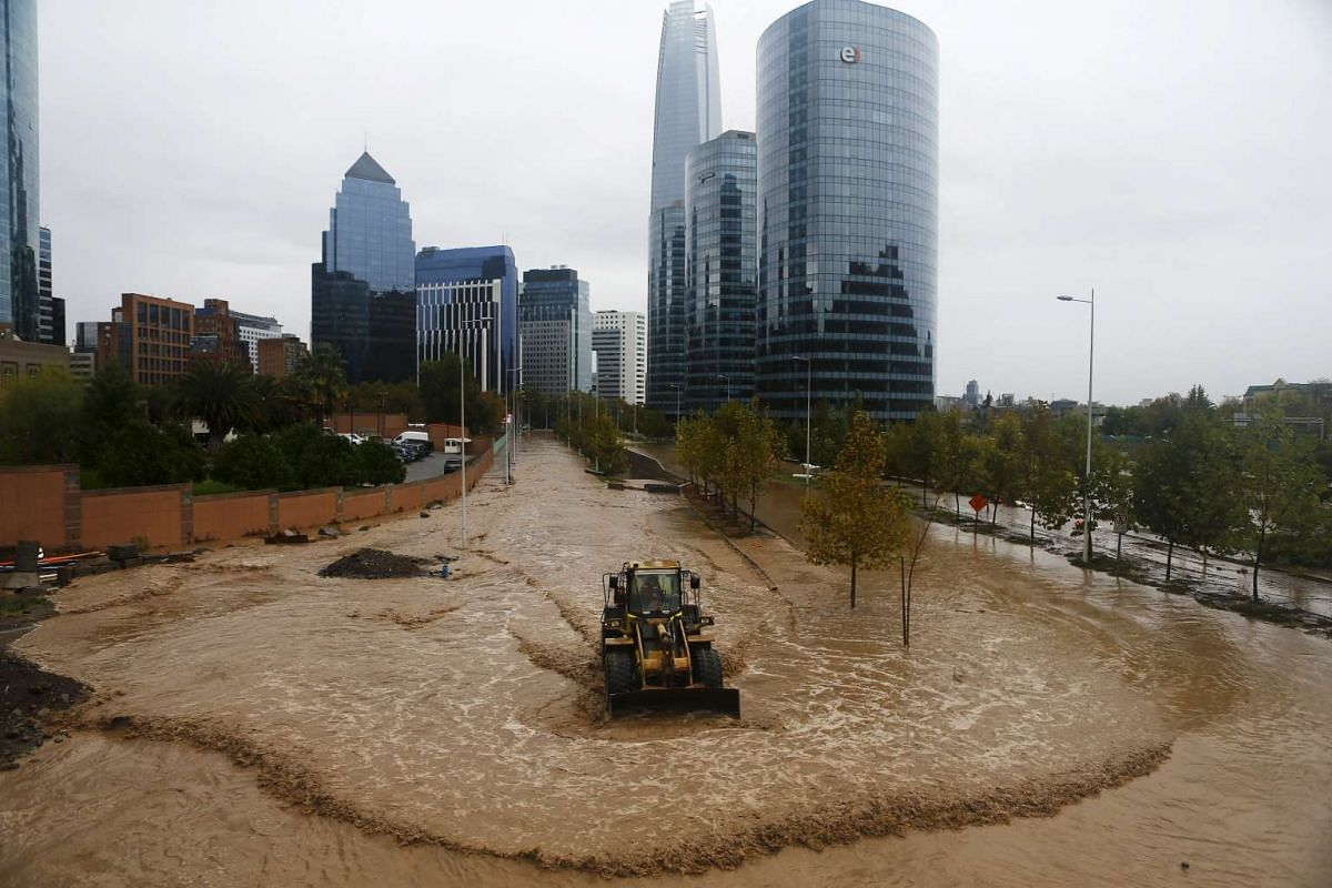 A loader working on a flooded street in Santiago, on April 17, 2016.