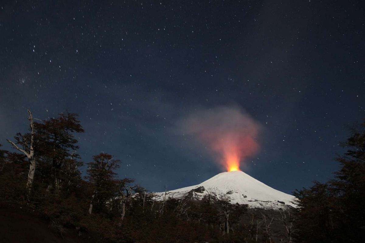 A view of the Villarrica volcano at dawn which continues to experience low intensity eruptions in Villarrica, Chile, on April 17, 2016.