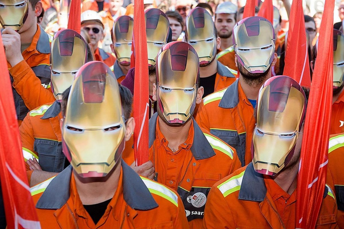 Trainees from steelmaker Saarstahl wearing Iron Man masks in Germany. The European country has accused China of dumping its steel products overseas.