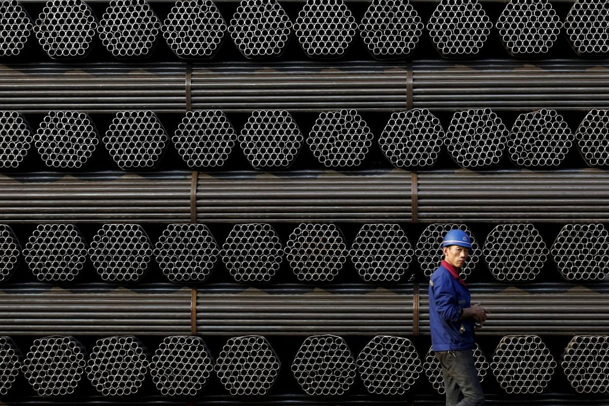 (Above and below) The steel foundries that dot Tangshan city have gone eerily quiet, their smoke stacks no longer billowing smoke and their gates shuttered. Inside, dust-covered tools lie abandoned, the workers who once wielded them are spending thei